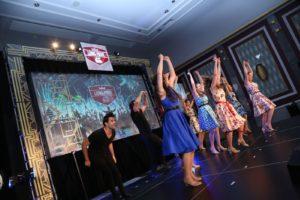 Corporate Entertainment Ideas Broadway Musical Revues Dancers Raised Hands